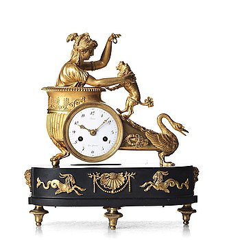 141. A French Empire early 19th century mantel clock.