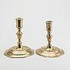 A set of four late baroque brass candlesticks.