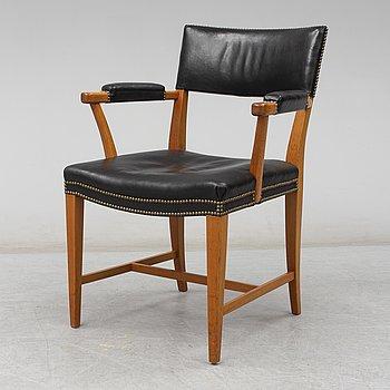 A mid 20th century modl 695 arm chair by Josef Frank for Firma Svenskt Tenn.