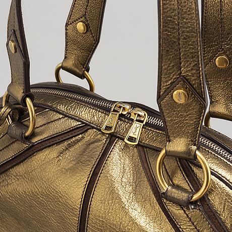 Yves saint laurent, a metallic bag.