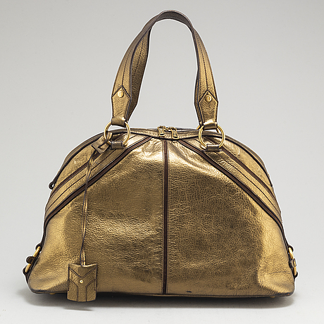 Yves saint laurent, a metallic bag.
