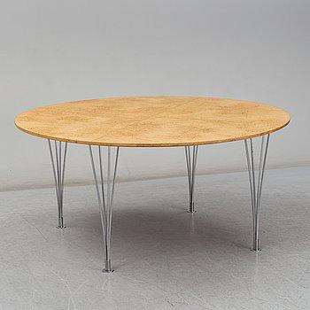 PIET HEIN & BRUNO MATHSSON, a curly birch veneered 'Supercirkel' table from Mathsson International and Fritz Hansen.