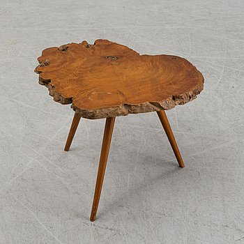 A mid 20th Century walnut and teak side table.