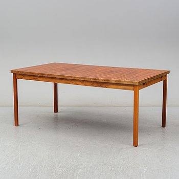 A second half of the 20th century rosewood veneered dining table.