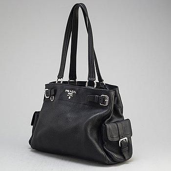 PRADA, a black leather bag.