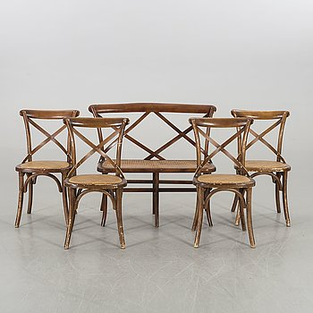 A wooden sofa, a table and four chairs, later part of the 20th century.