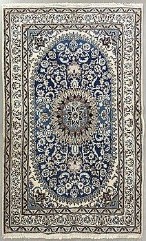 An old nain carpet ca 304 x 196 cm.