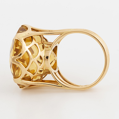 Round mixed-cut citrine cocktail ring.
