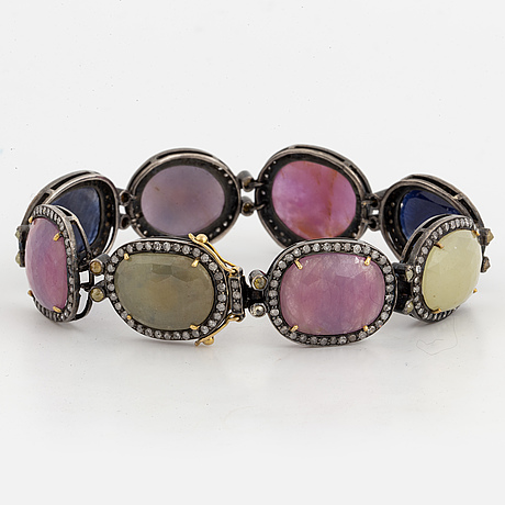 Bracelet with multicoloured stones, including ruby and diamond, silver and gold.