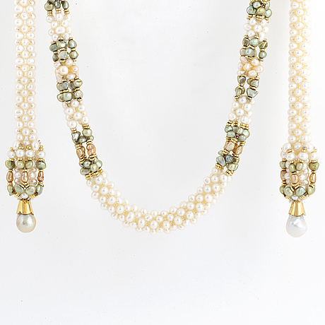 Green and white seed pearl with baroque shaped cultured pearl necklace.