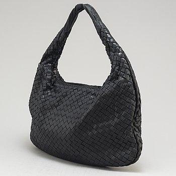 BOTTEGA VENETA, a black leather 'Veneta' bag.