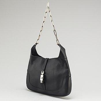 GUCCI, a black leather chain bag.