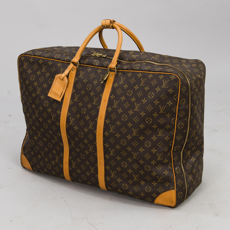 7c6c735096 LOUIS VUITTON Monogram Canvas Sirius 65 Suitcase. - Bukowskis