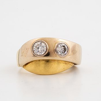 A ring with two brililant-cut diamonds.