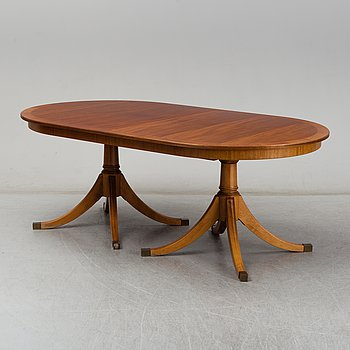 A second half of the 20th century regency style mahogany dining table with three additional leaves.