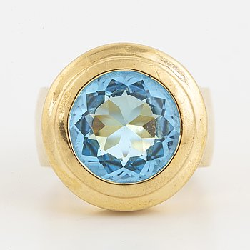 A faceted topaz ring.