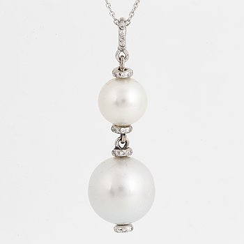 Cultured South sea pearl and saltwater pearl and diamond pendant, with chain.