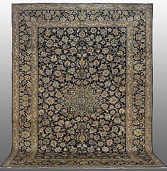 A carpet, Kashan, signed 383 x 279 cm.