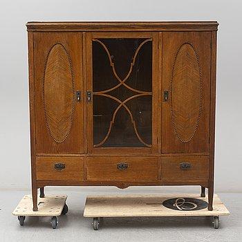 An early 20th Century oak art noveau vitrine.