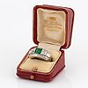 An 18k white gold wa bolin ring set with a faceted emerald and old-, eight- and baguette-cut diamonds.