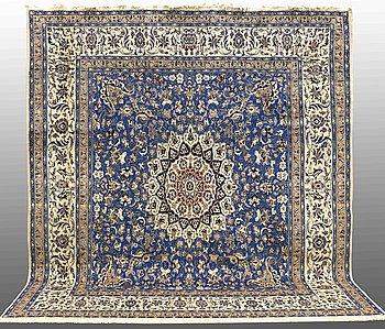 A carpet, Nain part silk, ca 302 x 292 cm.