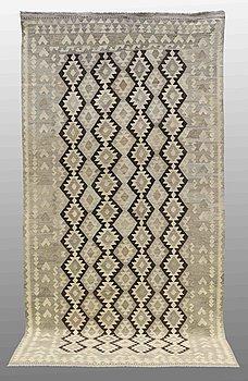 A carpet, kilim, around 363 x 182 cm.