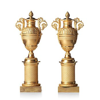 114. A pair of French Empire candlesticks, early 19th century.