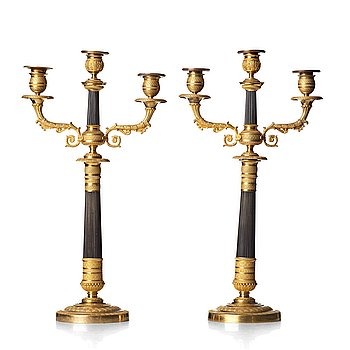 110. A pair of French Empire three-light candelabra, early 19th century.