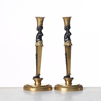 A pair of Empire style candlesticks. Late 19th century.