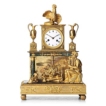 138. A French Empire early 18th century mantel clock.