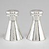 Sigurd persson, a pair of sterling silver candlesticks, stockholm 1954