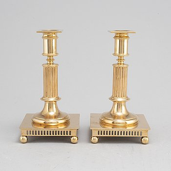 A pair of model 38 brass candlesticks from Gusums Bruk, first half of the 20th century.