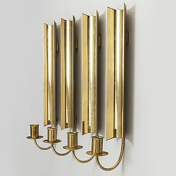 A set of four 'Reflex' brass wall scones by Pierre Forsell, Skultuna.