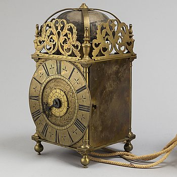 A late 17th or early 18th century lantern clock signed J Windmills London.