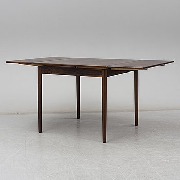 A rosewood dining table, Denmark, second haft of the 20th century.