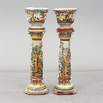 A pair of second half of the 20th century cream ware pedestals with flower pots, Capo di Monte, Italy.