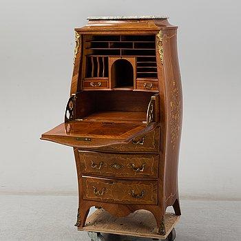 An end of the 19th Century rococostyle mahogany bureau.