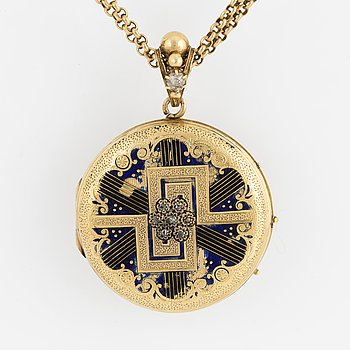 An 18K gold enamel and diamond locket. Chain in gold.