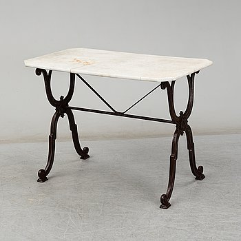 a cast iron and marble table from Corné & Cie Toulouse, around 1900.