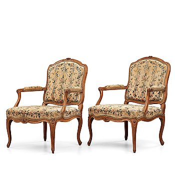 3. Two matched Louis XV armchairs by Charles Francois Normand (master in Paris 1747), mid 18th century.
