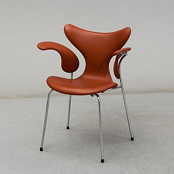 ARNE JACOBSEN, a 'Lily' leather covered armchair from Fritz Hansen, Denmark.