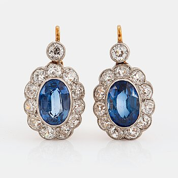 973. A pair of 14K gold and platinum earings set with faceted synthetic sapphires and old-cut diamonds.