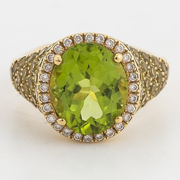 Peridot and brilliant-cut diamond ring.