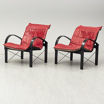 TORD BJÖRKLUND, a pair of 1980's leather armchairs for IKEA.