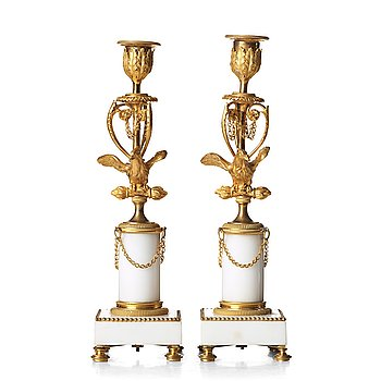 116. A pair of Louis XVI late 18th century candlesticks.