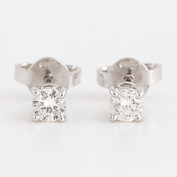 Brilliant-cut diamond stud earrings.