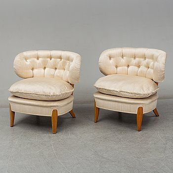 A pair of mid 20th Century easy chairs by Otto Schulz.