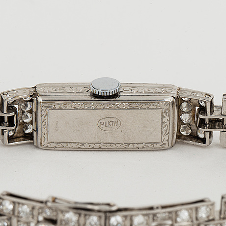 Platinum and brilliant-cut diamond art déco ladies watch.