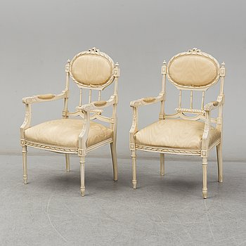 A 20th Century pair of Louis XVI style armchairs.