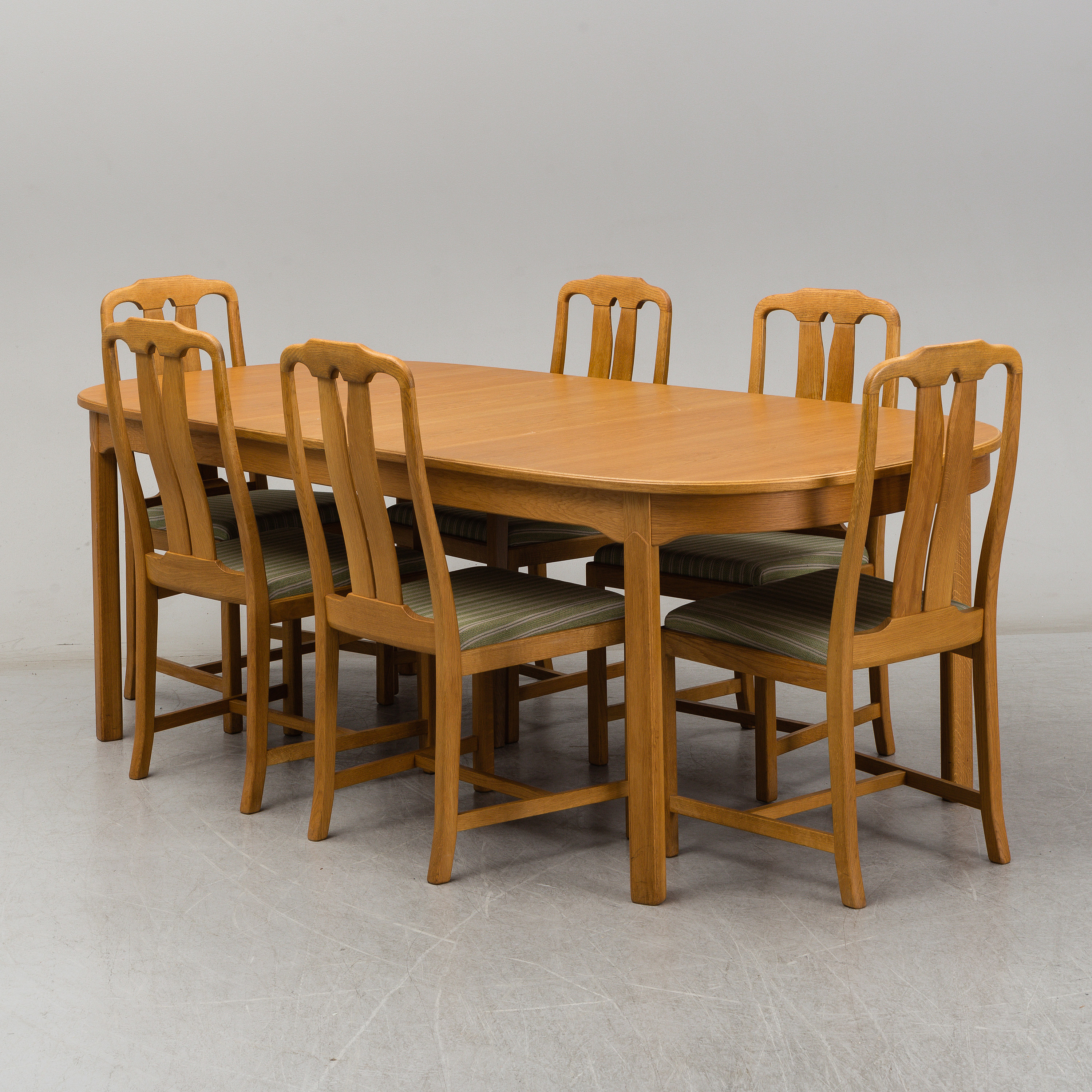 Six Ambassador Oak Chairs And Av Dining Table With One